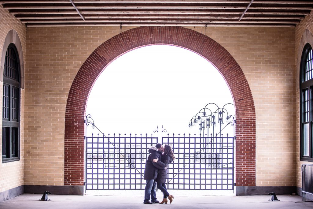 Kissing under the archway at the rail station