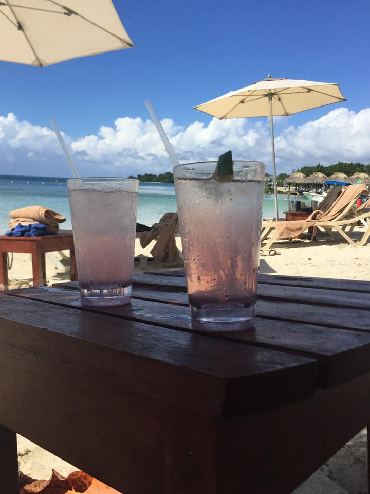 Two drinks on the beach.
