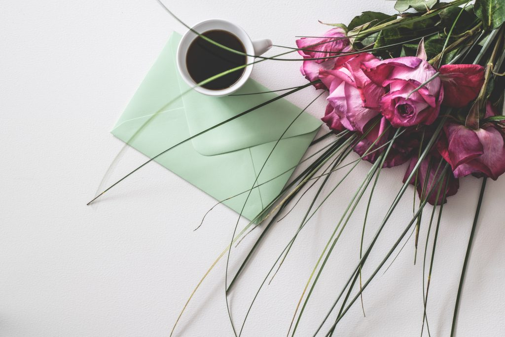 Coffee, a card, and a bouquet of flowers for Mother's Day.