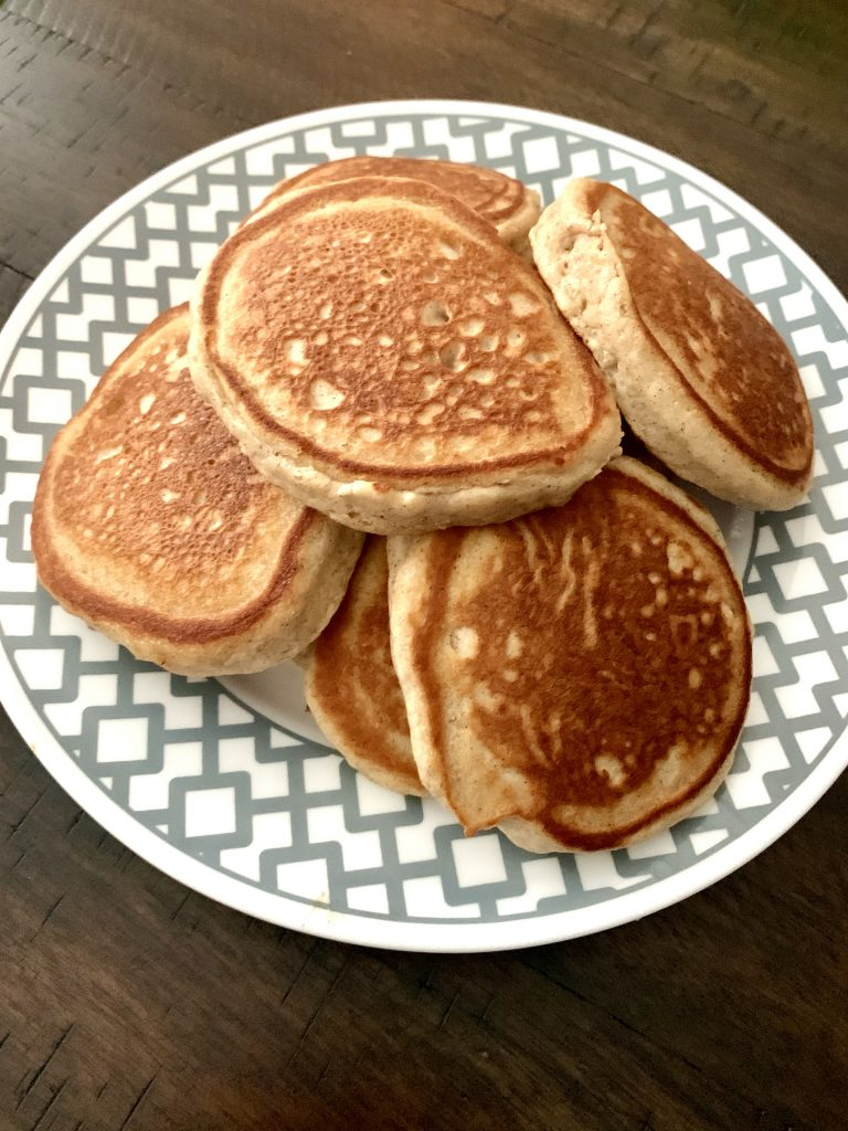 Finished pancakes on a plate.
