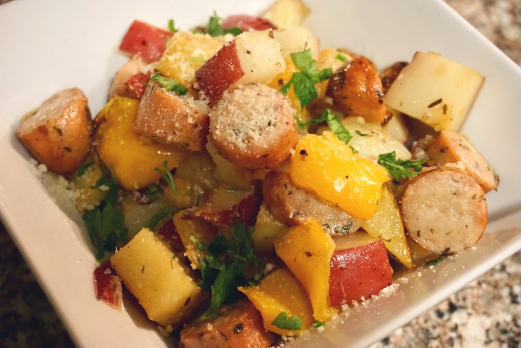 Sausage, potatoes, and peppers close up.