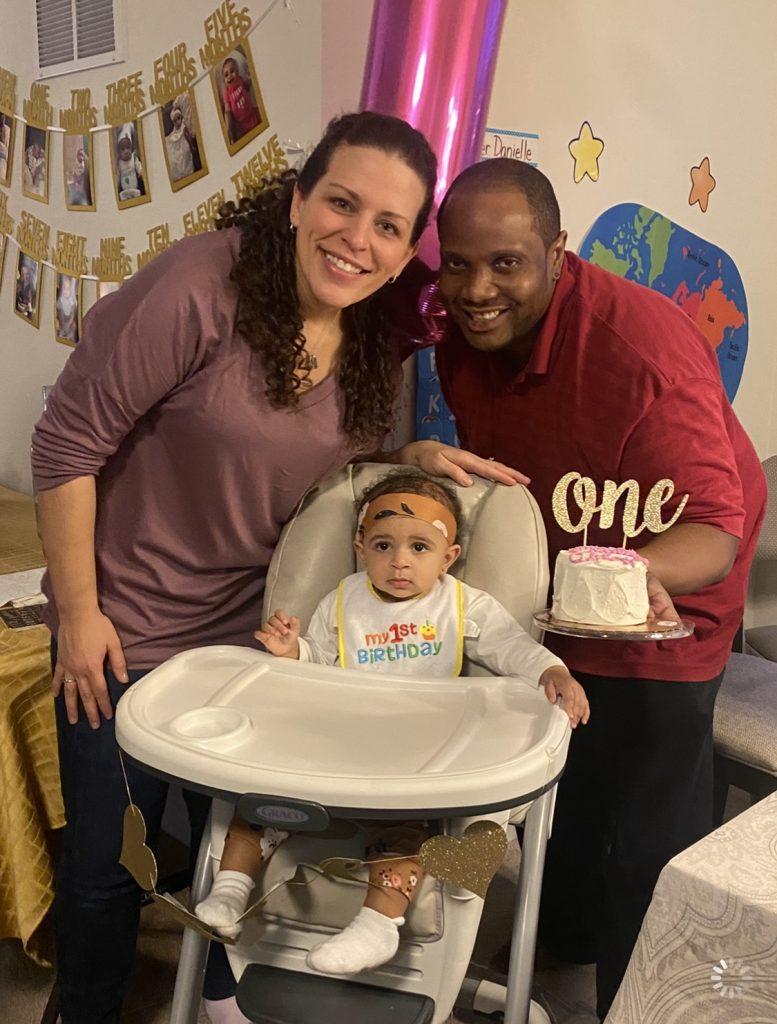 Family photo with birthday cake.