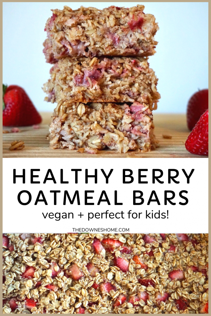 Berry oatmeal bars stacked with strawberries.