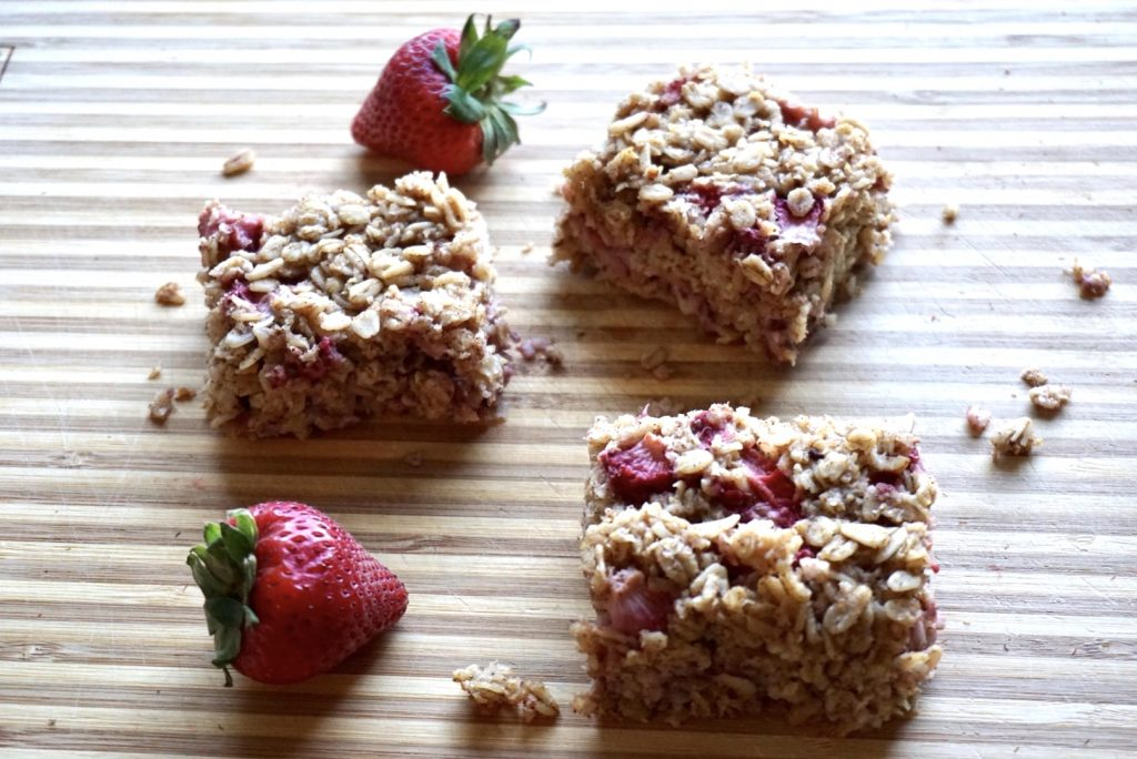 Berry oatmeal bars on plate.