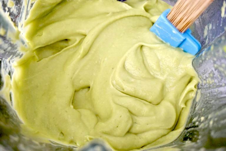 Pureed avocado baby food in blender.