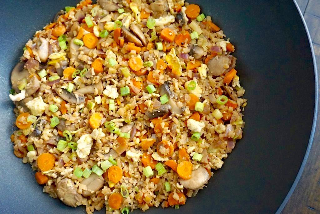 Cauliflower fried rice in a wok.