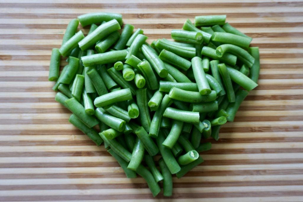 Pile of green beans shaped like a heart.