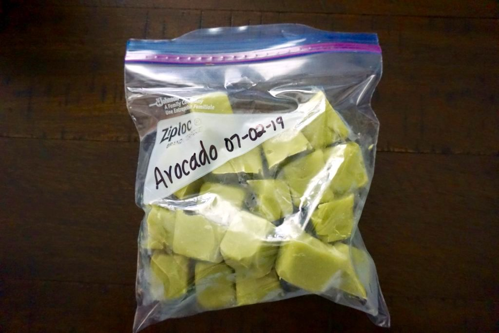 Frozen cubes of avocado baby food.